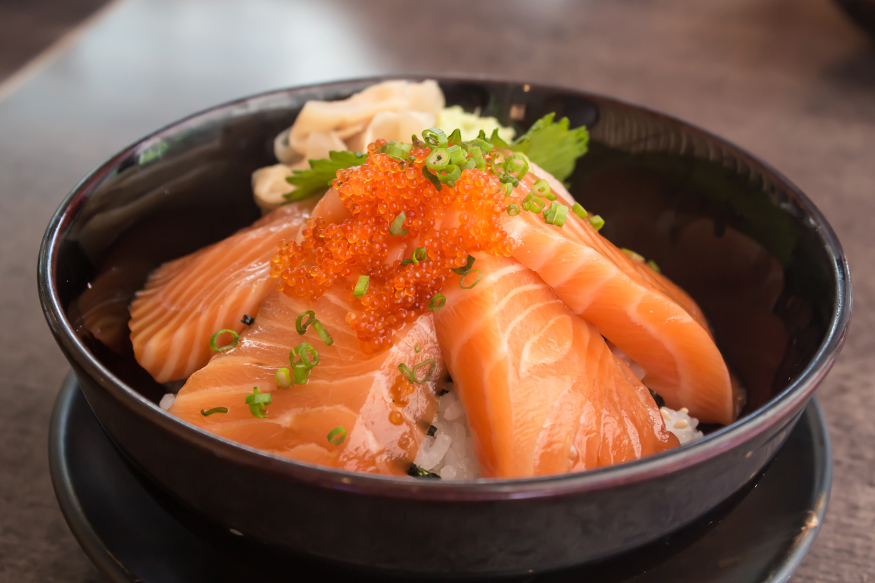 Salmon with rice in bowl