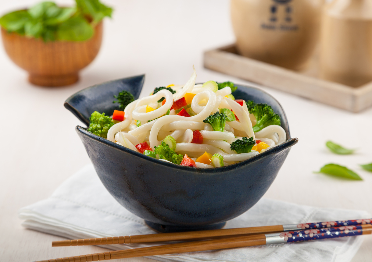 Udon, Japanese noodles with vegetables in a handmade ceramic bow
